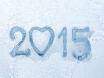 2015 auf Winterfensterhintergrund geschrieben Lizenzfreies Stockbild