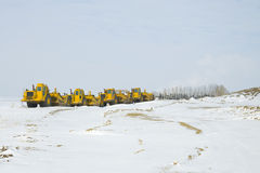 Aufbau-schwere Ausrüstung geparkt in einer Reihe Lizenzfreie Stockfotografie