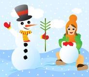 Aufbauen eines Schneemanns Stockfoto