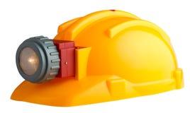 Aufbausturzhelm mit einer Taschenlampe Lizenzfreie Stockfotografie