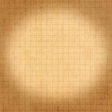 Aufbereitete Beschaffenheit oder Hintergrund des braunen Papiers mit Zelle und bokeh. Lizenzfreie Stockfotos