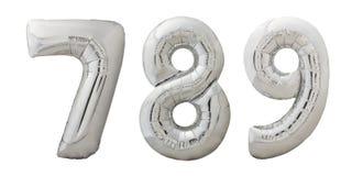 Aufblasbare Ballone Chromes nummeriert 7, 8, 9 auf Weiß Lizenzfreie Stockfotos
