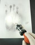 Aufdecken der Fingerabdrücke Lizenzfreie Stockbilder