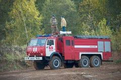 Aufgabe auf dem Feuer komnady Stockfotos