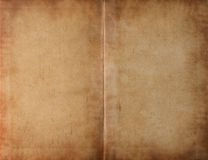 Aufgeklapptes dunkles befleckemes Papier des Buches Lizenzfreie Stockfotos