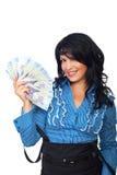 Aufgeregte Frau, die rumänische Banknoten anhält Stockfoto