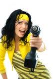 Aufgeregte Frau mit einem Bohrgerät lizenzfreies stockfoto