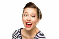 Aufgeregte junge Frau Stockfoto