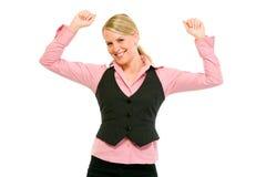 Aufgeregte moderne Geschäftsfrau, die ihren Erfolg genießt Stockbild