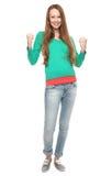 Aufgeregte zusammenpressende Fäuste der jungen Frau Stockfotos