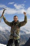 Aufgeregter Bergsteiger Stockfotos