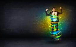 Aufgeregter Geschäftsmann, der mit bunten Linien der Energie springt Lizenzfreies Stockfoto