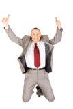 Aufgeregter Geschäftsmann, der mit okayzeichen springt Stockfotografie