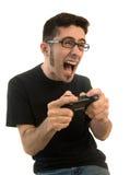Aufgeregter Mann, der Videospiele spielt Stockfoto