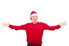Aufgeregter Mann mit dem Sankt-Hutbegrüßen Stockfotos
