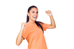 Aufgeregtes junges Mädchen, das mit den Händen angehoben lächelt Lizenzfreie Stockfotos