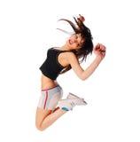 Aufgeregtes junges Mädchen, das auf Weiß springt Stockfotos