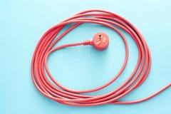Aufgerolltes Rotes Elektrisches Kabel Oder Führung Mit Stecker Lizenzfreies  Stockbild