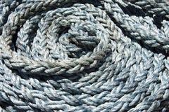 Aufgerolltes Seil des Hintergrundes Stockfoto