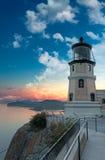 Aufgeteilter Felsen-Leuchtturm-Sonnenuntergang mit Mond Lizenzfreie Stockfotos