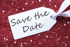 Aufkleber auf rotem Hintergrund, Schneeflocken, englische Text-Abwehr das Datum stockfotografie
