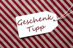 Aufkleber auf rotem Packpapier, Geschenk Tipp bedeutet Geschenk-Tipp Stockbilder
