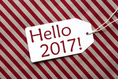 Aufkleber auf rotem Packpapier, Text hallo 2017 Lizenzfreie Stockbilder