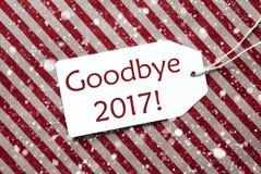 Aufkleber auf rotem Papier, Schneeflocken, Text Auf Wiedersehen 2017 Stockfotografie