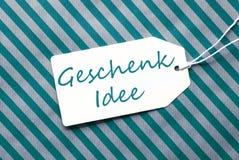 Aufkleber auf Türkis-Packpapier, Geschenk Idee bedeutet Geschenk-Idee Lizenzfreie Stockfotos