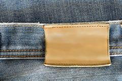 Aufkleber des Blue Jeans-freien Raumes Lizenzfreie Stockfotos