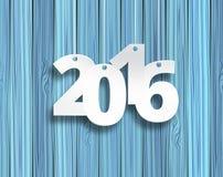 Aufkleber des Designaufkleber-Textes 2016 auf einem hölzernen Hintergrund Lizenzfreies Stockbild