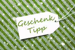 Aufkleber, grünes Packpapier, Geschenk Tipp bedeutet Geschenk-Tipp, Schneeflocken Stockfotografie