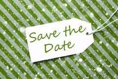 Aufkleber, grünes Packpapier, Text-Abwehr das Datum, Schneeflocken Lizenzfreie Stockbilder