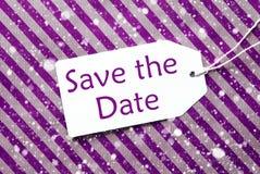 Aufkleber, purpurrotes Packpapier, Text-Abwehr das Datum, Schneeflocken Lizenzfreie Stockbilder