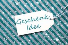 Aufkleber, Türkis-Packpapier, Geschenk Idee bedeutet Geschenk-Idee, Schneeflocken Stockfoto