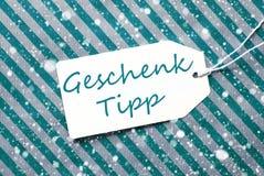 Aufkleber, Türkis-Packpapier, Geschenk Tipp bedeutet Geschenk-Tipp, Schneeflocken Stockbild