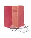 Aufrechte alte Bibel und Lesegläser Stockfotografie