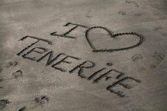 Aufschrift auf dem grauen Sand stockbilder