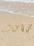 Aufschrift 2017 auf dem Sand Lizenzfreies Stockfoto