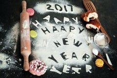Aufschrift 2017 des neuen Jahres des Mehls auf dem Tisch Lizenzfreie Stockbilder