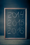 Aufschrift 2014 Kreide 2015 2016 auf einer Tafel Lizenzfreies Stockfoto