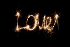 Aufschrift - Liebe von Wunderkerzen Stockfoto