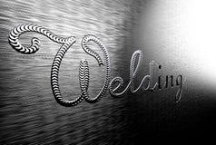 Aufschriftschweißen auf einer Metallplatte Stockbilder
