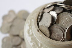 Aufspeicherung der Münzen Stockfoto