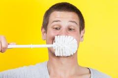 Auftragende Zähne Stockfoto