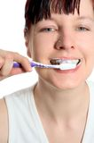 Auftragende Zähne Stockbild