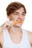 Auftragende Zähne des jungen Mannes nah herauf Eintragfaden lizenzfreies stockbild