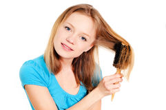 Auftragendes Haar der Frau Stockfoto