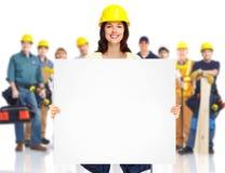 Auftragnehmerfrau und Gruppe Industriearbeiter. Stockfoto