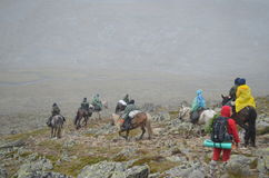 Aug 18, 2012 - a Group of tourists on horseback go through the S royalty free stock images
